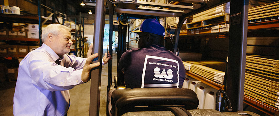 SAS Warehouse Workers and Forklift